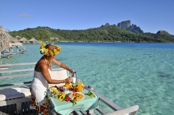 Serving breakfast at Bora Bora