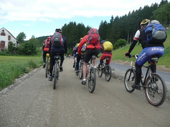 A group cycling tour in the mountains