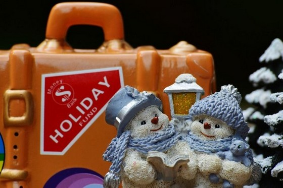 'Holiday Fund' piggy bank with winter-themed figurines